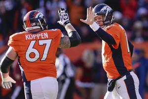 photo - Denver Broncos quarterback Peyton Manning (18) gets a high five from Denver Broncos center Dan Koppen (67) after Manning threw a touchdown pass against the Cleveland Browns in the first quarter of an NFL football game, Sunday, Dec. 23, 2012, in Denver. (AP Photo/Joe Mahoney)
