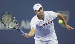 Photo -   Andy Roddick returns a shot to Argentina's Juan Martin Del Potro in the fourth round of the 2012 US Open tennis tournament, Tuesday, Sept. 4, 2012, in New York. (AP Photo/Charles Krupa)