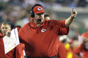 Photo - Kansas City Chiefs coach Andy Reid calls a play during the second half of an NFL football game against the Philadelphia Eagles, Thursday, Sept. 19, 2013, in Philadelphia. (AP Photo/Matt Rourke)