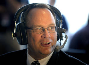 Photo - Big 12 Commissioner Dan Beebe speaks during a radio interview at the NCAA college football Big 12 Media Days, Tuesday, July 26, 2011, in Dallas. (AP Photo/Matt Strasen)