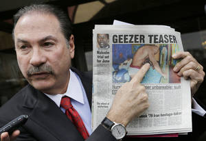 Photo - Attorney Howard Fensterman, representing the East Neck Nursing and Rehabilitation Center, points to a newspaper article about the nursing home during a news conference, Tuesday, April 8, 2014. in West Babylon, N.Y. The nursing home hired a male exotic dancer to perform for its patients, according to a lawsuit filed by facility resident Bernice Youngblood in State Supreme Court in Suffolk County. Fensterman acknowledged the home hired the dancer, but said that Youngblood's attendance was voluntary. (AP Photo/Mark Lennihan)