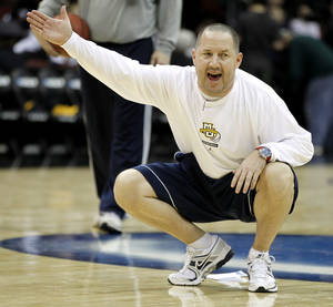 Photo - Marquette has finalized a new deal with coach Buzz Williams, taking him out of consideration for the OU head coaching job. AP PHOTO