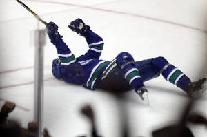 Photo - Vancouver Canucks' Henrik Sedin celebrates his goal against the Phoenix Coyotes during second period NHL hockey action in Vancouver, British Columbia, on Friday Dec. 6, 2013. (AP Photo/The Canadian Press, Ben Nelms)