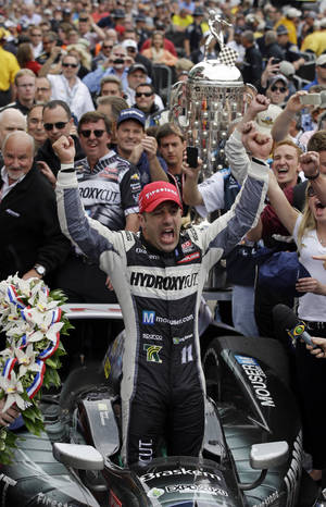 Photo - FILE - In this May 26, 2013, file photo, Tony Kanaan, of Brazil, celebrates after winning the Indianapolis 500 auto race at the Indianapolis Motor Speedway in Indianapolis. The Associated Press has learned Kanaan will not return to KV Racing next season and is finalizing a deal to join Chip Ganassi Racing.  Two people familiar with Kanaan's plan said Friday, Sept. 27,2 013, that the Brazilian is nearing a signed contract with Ganassi. They spoke on condition of anonymity because Ganassi has not announced the move.  (AP Photo/Darron Cummings, File)