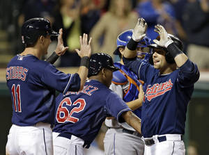 Photo - Cleveland Indians' Nick Swisher, right, celebrates with Drew Stubbs (11) and Jose Ramirez (62) after a grand slam off New York Mets relief pitcher Tim Byrdak in the eighth inning of a baseball game Friday, Sept. 6, 2013, in Cleveland. (AP Photo/Mark Duncan)