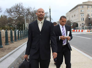 Photo - FILE - This April 2, 2014 file photo shows former Northwestern University football quarterback Kain Colter, right, and Ramogi Huma, founder and president of the National College Players Association arrive on Capitol Hill in Washington. The United Steelworkers union and college football players may seem like an unlikely pairing.  Yet the sprawling union is locked in a high-stakes standoff with Northwestern University over whether student athletes on scholarships should be allowed to unionize, engage in collective bargaining and even strike. At first glance, it may seem like a big reach on the part of the union. But it's been a long time since the Steelworkers Union just represented workers at steel mills and in other jobs directly related to steel. (AP Photo/Lauren Victoria Burke, File)