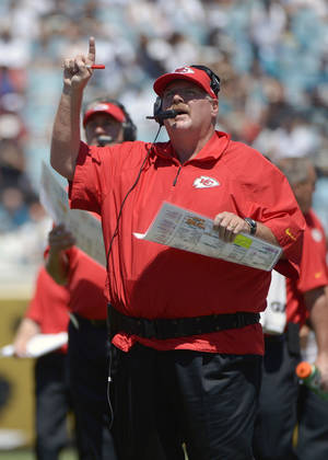 Photo - Kansas City Chiefs head coach Andy Reid motions to his players during the first half of an NFL football game against the Jacksonville Jaguars in Jacksonville, Fla., Sunday, Sept. 8, 2013.(AP Photo/Phelan M. Ebenhack)