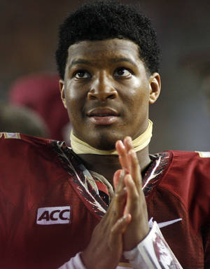 Photo - ADD UPDATES ABOUT NO CHARGES FILED - FILE - In this Sept. 21, 2013, file photo, Florida State quarterback Jameis Winston watches from the sidelines during the second half of an NCAA college football game against Bethune-Cookman in Tallahassee, Fla. Search warrants, released Thursday, Dec. 5, 2013, in the sexual assault investigation of Winston indicate the woman told police she was raped at an apartment after a night of drinking at a bar. State Attorney Willie Meggs said there was not enough evidence to pursue charges in the sex assault case against Winston. (AP Photo/Phil Sears, File)