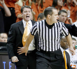 Photo - OSU coach Travis Ford shouts from behind an official during the NCAA college basketball game between Oklahoma State and Texas in Stillwater, Okla., Saturday, Feb. 28, 2009. PHOTO BY BRYAN TERRY, THE OKLAHOMAN