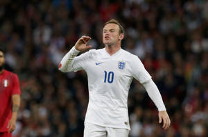Photo - England's Wayne Rooney shouts instructions to a teammate during the international friendly soccer match between England and Peru at Wembley Stadium in London, Friday, May 30, 2014.  (AP Photo/Matt Dunham)
