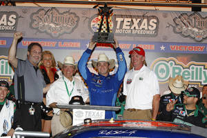 Photo - Ricky Stenhouse Jr. celebrates in victory lane after winning the NASCAR Nationwide Series auto race, Friday, April 13, 2012, in Fort Worth, Tex. (AP Photo/Autostock, Russell LaBounty) MANDATORY CREDIT ORG XMIT: TXNK344