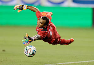 Photo - Honduras' Donis Izaguirre (22) can't stop the shot of Israel's Eran Zahavi as he scores in the first half during a soccer match Sunday, June 1, 2014, in Houston. (AP Photo/Bob Levey)