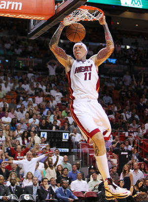 Photo - Miami Heat's Chris Andersen dunks against the Orlando Magic during the third quarter of their NBA basketball game, Wednesday, April 17, 2013, in Miami. The Heat won 105-93. (AP Photo/El Nuevo Herald, David Santiago)  MAGS OUT