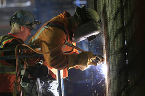 Photo - FILE - In this May 1, 2014 file photo, welders connect iron support bars during construction inside the cavern of the Second Avenue subway tunnel at 86th Street, in New York. The Commerce Department releases construction spending for April, on Monday, June 2, 2014. (AP Photo/Bebeto Matthews, File)