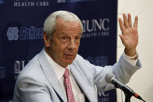 photo -   North Carolina coach Roy Williams responds to questions during the team&#039;s NCAA college basketball media day in Chapel Hill, N.C., Thursday, Oct. 11, 2012. (AP Photo/Gerry Broome)  