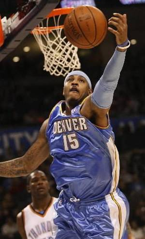 photo - Denver Nuggets forward Carmelo Anthony, right, grabs a rebound in front of Oklahoma City Thunder guard Kevin Durant, left, in the second quarter of an NBA basketball game in Oklahoma City, Friday, Jan. 2, 2009. (AP Photo/Sue Ogrocki)