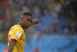 Photo - Cameroon's Samuel Eto'o gestures during the group A World Cup soccer match between Mexico and Cameroon in the Arena das Dunas in Natal, Brazil, Friday, June 13, 2014.  (AP Photo/Sergei Grits)