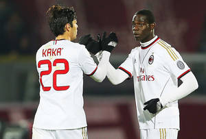 Photo - AC Milan's Mario Balotelli, right, celebrates with teammate Kaka after scoring during a Serie A soccer match between Livorno and AC Milan in Leghorn, Italy, Saturday, Dec. 7, 2013. (AP Photo/Francesco Speranza)
