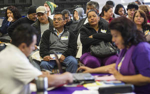 Photo - Applicants wait during a health care enrollment event at SEIU-UHW office, Monday, March 31, 2014, in Commerce, Calif.  Monday marks this year's open enrollment deadline, but consumers will get extra time to finish their applications.  (AP Photo/Ringo H.W. Chiu)