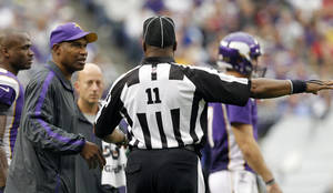 Photo -   Minnesota Vikings head coach Leslie Frazier, left, talks with side judge Dwayne Strozier, right, during the second half of an NFL football game against the San Francisco 49ers Sunday, Sept. 23, 2012, in Minneapolis. The Vikings won 24-13. (AP Photo/Genevieve Ross)