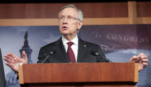 photo - FILE - In this March 14, 2013 file photo, Senate Majority Leader Harry Reid, D-Nev., speaks during a news conference on Capitol Hill in Washington. Gun control legislation the Senate debates next month will include an expansion of federal background checks for firearms buyers, Reid said Thursday, March 21, 2013, in a victory for advocates of gun restrictions. (AP Photo/Cliff Owen, File)