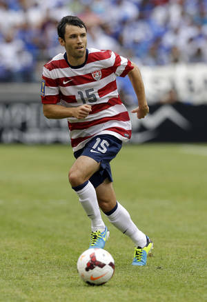 Photo - FILE - In this July 21, 2013 file photo, United States' Michael Parkhurst dribbles the ball during the first half in the quarterfinals of the CONCACAF Gold Cup soccer tournament against El Salvador, in Baltimore.  Parkhurst is thrilled to be back in Major League Soccer with the Columbus Crew at age 30, and reported to the U.S. World Cup training camp last week hoping to land a spot from a deep pool of defenders on Jurgen Klinsmann's 23-man roster headed to Brazil next month. (AP Photo/Patrick Semansky, File)