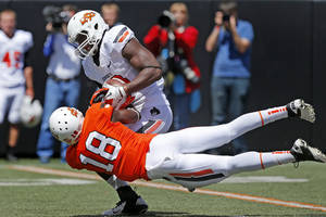 Photo - Oklahoma State's Deion Imade pulls the ball away from Blake Jackson for an incompletion during OSU's spring football game at Boone Pickens Stadium in Stillwater, Okla., Sat., April 20, 2013. Photo by Bryan Terry, The Oklahoman