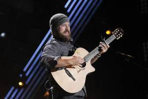 """Photo - File photo - In this June 9, 2011 photo, Zac Brown of the Zac Brown Band performs during the CMA Fan Fest in Nashville, Tenn. The group's latest album, """"Uncaged,"""" is scheduled for release on July 10. (AP Photo/Wade Payne, File)"""