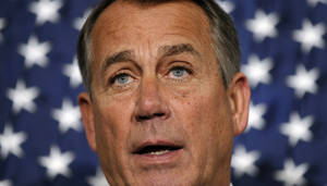 Photo - House Speaker John Boehner of Ohio speaks during a new conference following a meeting at the Republican National Committee offices on Capitol Hill in Washington, Wednesday, Oct. 23, 2013. (AP Photo/Susan Walsh)