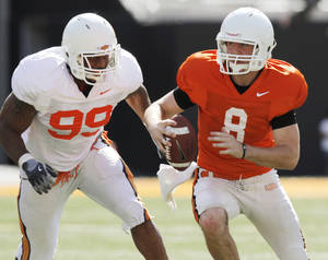 Photo - COLLEGE FOOTBALL: OSU's Richetti Jones (99) chases Johnny Deaton (8) during the Orange/White spring football game for the Oklahoma State University Cowboys at Boone Pickens Stadium in Stillwater, Okla., Saturday, April 16, 2011. Photo by Nate Billings, The Oklahoman ORG XMIT: KOD