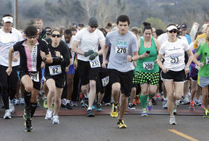 "Photo - Runners take off in the ""Run Your Cookies Off"" race sponsored by  Junior Girl Scout Troop 889 in Edmond. PHOTO BY PAUL HELLSTERN, THE OKLAHOMAN. <strong>PAUL HELLSTERN - OKLAHOMAN</strong>"