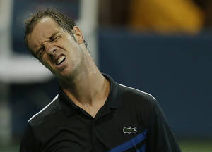 Photo - Richard Gasquet, of France, reacts after losing a point to Milos Raonic, of Canada, during the fourth round of the 2013 U.S. Open tennis tournament, Monday, Sept. 2, 2013, in New York. (AP Photo/Mike Groll)
