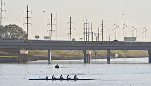 Photo - Competitors are lit by the morning sun as they warm up before competing during the Oklahoma Regatta Festival at the Oklahoma River on Saturday, Oct. 1, 2011, in Oklahoma City, Okla. Photo by Chris Landsberger, The Oklahoman