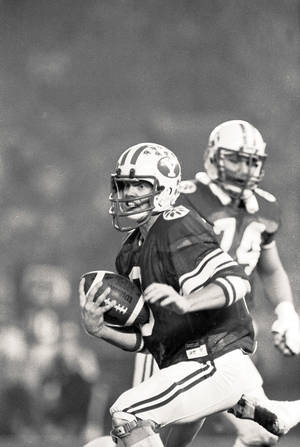 photo - Jim McMahon attended BYU and played quarterback for the Cougars. AP Archive Photo