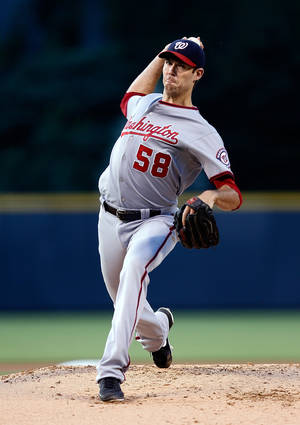 Photo - Washington Nationals starting pitcher Doug Fister throws to the plate against the Colorado Rockies during the first inning of a baseball game on Monday, July 21, 2014, in Denver. (AP Photo/Jack Dempsey)