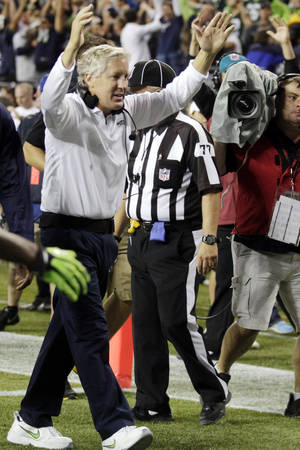 Photo -   Seattle Seahawks head coach Pete Carroll celebrates a last-second touchdown by wide receiver Golden Tate to defeat the Green Bay Packers 14-12 in an NFL football game, Monday, Sept. 24, 2012, in Seattle. (AP Photo/Stephen Brashear)