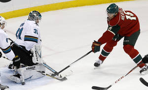 Photo - San Jose Sharks goalie Antti Niemi (31), of Finland, deflects a shot off his pads by Minnesota Wild left wing Dany Heatley (15) during the first period of an NHL hockey game in St. Paul, Minn., Sunday, Dec. 8, 2013. (AP Photo/Ann Heisenfelt)