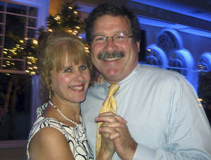 Photo - FILE - This undated photo, provided by Bill Sherlach, shows him with his wife, school psychologist Mary Sherlach, who was killed Friday, Dec. 14, 2012, when a gunman opened fire at Sandy Hook Elementary School in Newtown, Conn. Sherlach doesn't know if a lack of mental health care contributed to the shootings that took the life of his wife and 25 others inside the Sandy Hook Elementary school. But Sherlach, whose wife, Mary, was the school's psychologist, is convinced that more and better school mental services can save lives in the future and help other children.  (AP Photo/Courtesy of Bill Sherlach, File)