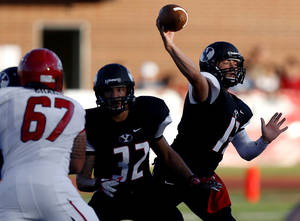 Photo - Yukon's Hayden Somerville, right, throws a pass last season. Photo by Bryan Terry, The Oklahoman Archives