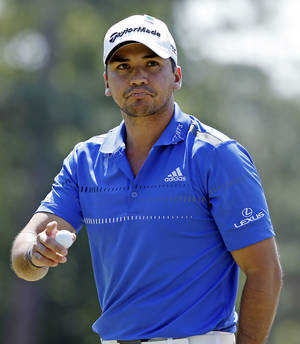 Photo - Jason Day, of Australia, holds up his ball after putting on the eighth hole during the third round of the Masters golf tournament Saturday, April 12, 2014, in Augusta, Ga. (AP Photo/Matt Slocum)