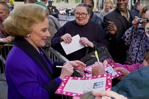 "Photo - FILE - In this Feb. 14, 2001 file photo, ""Dear Abby"" advice columnist Pauline Friedman Phillips, 82, known to millions of readers as Abigail van Buren, signs autographs for some of dozens of fans after the dedication of a ""Dear Abby"" star on the Hollywood Walk of Fame in Los Angeles.  Phillips, who had Alzheimer's disease, died Wednesday, Jan. 16, 2013, she was 94.  Phillips' column competed for decades with the advice column of Ann Landers, written by her twin sister, Esther Friedman Lederer. Their relationship was stormy in their early adult years, but later they regained the close relationship they had growing up in Sioux City, Iowa. The two columns differed in style. Ann Landers responded to questioners with homey, detailed advice. Abby's replies were often flippant one-liners. (AP Photo/Reed Saxon)"