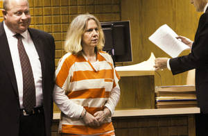 photo - Becky Bryan and her attorney, Gary James, appeared Tuesday before District Judge Gary E. Miller at the Canadian County Courthouse for a preliminary hearing on a first-degree murder charge. Photo by Jim Beckel, THE OKLAHOMAN
