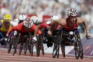 Photo -   Tatyana McFadden of the United Sates, right looks as she competes in a women's 1500-meter T54 category heat at the 2012 Paralympics games, Thursday, Sept. 6, 2012, in London. (AP Photo/Alastair Grant)