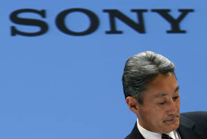 Photo - Sony Corp. President and CEO Kazuo Hirai reacts during a press conference at the Sony headquarters in Tokyo Thursday, Feb. 6, 2014. Sony is in talks to sell its troubled personal computer business and Thursday lowered its earnings forecast for the business year ending March to a 110 billion yen loss ($1.1 million).The company also said it's cutting its global workforce by about 3 percent or 5,000 people by the end of March 2015 as it restructures its PC, television and other businesses. (AP Photo/Shizuo Kambayashi)