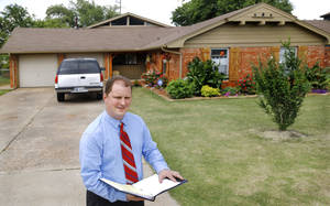 Photo -  State Rep. Jon Echols stands in front of 4111 Holiday Place, were a house fire occurred in December 2012. The ensuing repairs were deemed improvements by the Oklahoma County Assessor's Office, resulting in an 11.18 percent hike in the owner's property taxes.   <strong>Jim Beckel -  THE OKLAHOMAN </strong>
