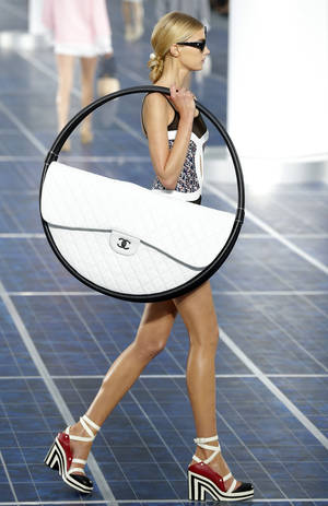 Photo -   A model wears a creation by German fashion designer Karl Lagerfeld for Chanel's ready to wear Spring-Summer 2013 collection, presented in Paris,Tuesday, Oct.2, 2012. (AP Photo/Jacques Brinon)