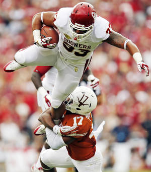 Photo - UT's Adrian Phillips (17) brings down OU's Trey Millard (33) in the first quarter during the Red River Rivalry college football game between the University of Oklahoma Sooners and the University of Texas Longhorns at the Cotton Bowl Stadium in Dallas, Saturday, Oct. 12, 2013. Photo by Nate Billings, The Oklahoman