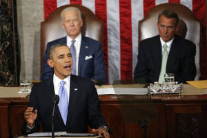Photo - President Barack Obama gives his State of the Union address on Capitol Hill in Washington, Tuesday Jan. 28, 2014, as Vice President Joe Biden and House Speaker John Boehner of Ohio, listen. (AP Photo/Charles Dharapak)