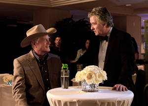 "Photo - This publicity image released by TNT shows Larry Hagman as J.R. Ewing, left, and Patrick Duffy as Bobby Ewing in a scene from ""Dallas,"" on TNT.  TNT begins the second season of its ""Dallas"" revival next month. The network said Tuesday, Dec. 11, that it will hold a funeral for Larry Hagman's memorable character at some point in the 15-episode season but that it hasn't been filmed or scheduled yet. Hagman died at age 81 over the Thanksgiving weekend. (AP Photo/TNT, Zade Rosenthal)"