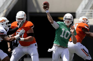 Photo - Oklahoma State's Clint Chelf throws a pass during OSU's spring football game at Boone Pickens Stadium in Stillwater, Okla., Sat., April 20, 2013. Photo by Bryan Terry, The Oklahoman